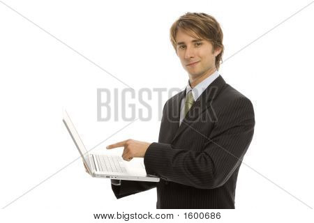 Businessman Points To Laptop