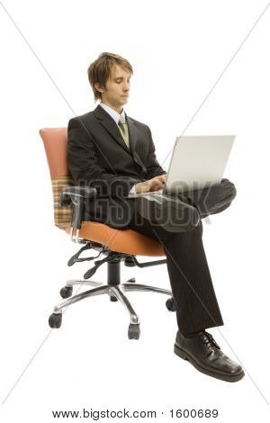 Businessman In Seat With Laptop
