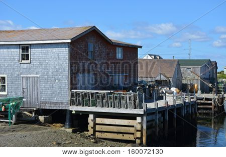 Weathered wooden boathouses are a common site at Peggy's Cove in Nova Scotia