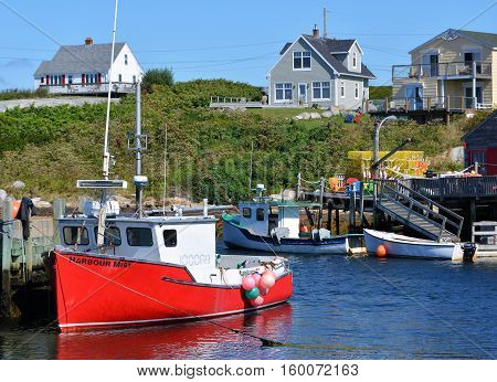 PEGGY'S COVE, NS. - AUGUST, 2016: Rustic fishing boats are docked in the village at Peggy's Cove.