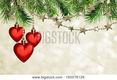 Christmas garlands with stars and red hearts decoration on holiday background with pine tree twigs