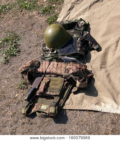 military camouflage uniforms and helmet, body armor boots.
