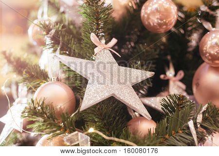 Glamorous Christmas tree. Pink balls and star