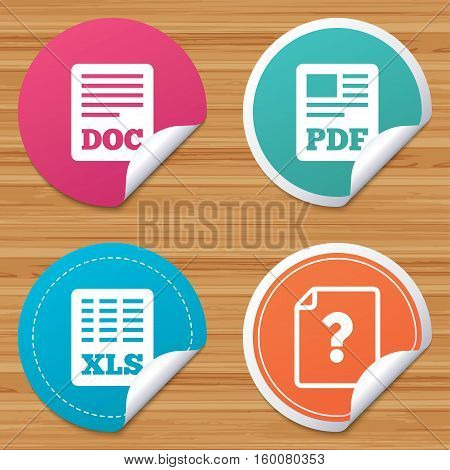 Round stickers or website banners. File document and question icons. XLS, PDF and DOC file symbols. Download or save doc signs. Circle badges with bended corner. Vector
