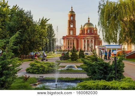 STROITEL, BELGOROD REGION, RUSSIA - JUNE 17 2016: District center in the Belgorod region. One of the most well-appointed Russian small towns. Alley overlooking the current Orthodox church in honor of the New Martyrs and Confessors of Belgorod.