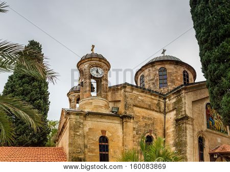 The Cana Greek Orthodox Wedding Church in Cana of Galilee Kfar Kana in winter cloudy day Israel. View of the domes close-up