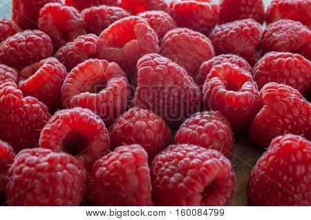 Extreme close-up image of raspberries, background image