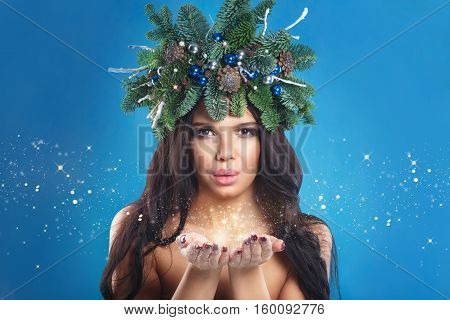 Winter Christmas Woman. Beautiful New Year And Christmas Holiday Girl Blowing Snow. Snowflakes. Hair