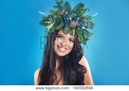 Christmas or New Year Beauty. Smiling Model Woman with Brunette Hair and Makeup Laughing. Girl with Curly Hairstyle on Party Background