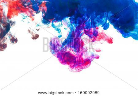 Color drop underwater creating a silk drapery. Ink swirling underwater. Cloud of colorful ink