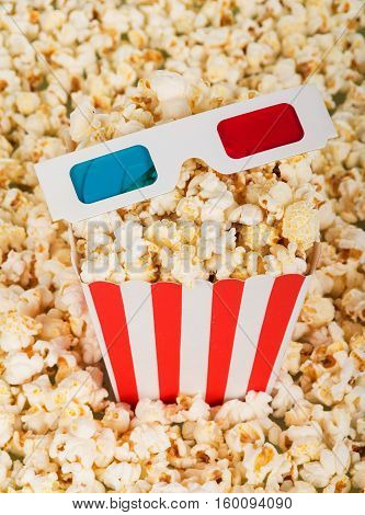 Complete box and 3D glasses on popcorn background