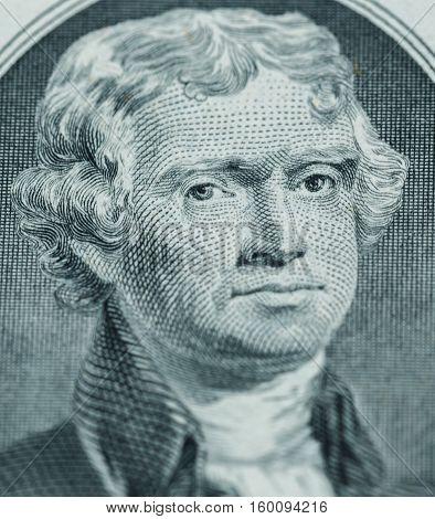 President Thomas Jefferson face on us two dollar bill closeup macro united states money