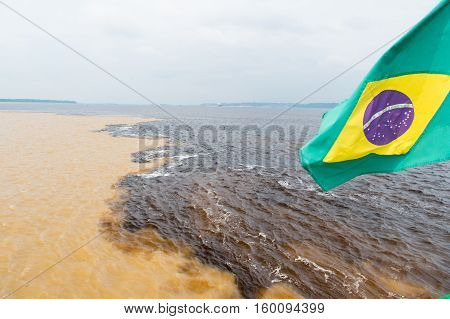 Water Meeting In Brazil -amazon River With Rio Del Negro