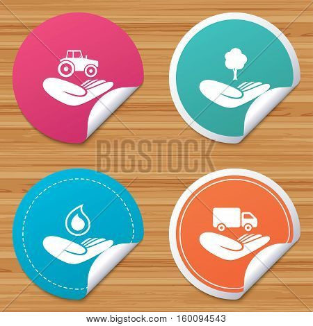 Round stickers or website banners. Helping hands icons. Agricultural tractor insurance symbol. Delivery truck sign. Save nature forest. Water drop. Circle badges with bended corner. Vector
