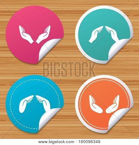 Round stickers or website banners. Hands icons. Insurance protection signs. Human helping donation hands. Prayer meditation hands sybmols. Circle badges with bended corner. Vector