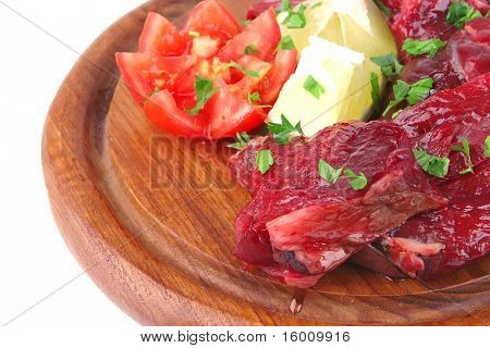 uncooked small beef chunks on wooden plate