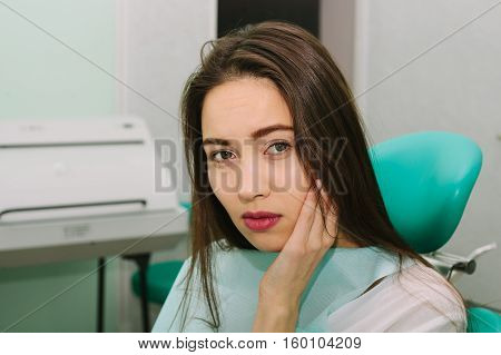 young beautiful woman on reception at the dentist.