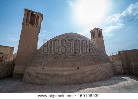 Wind catcher towers of ancient water reservoir in Kashan city Iran