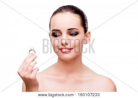 Woman with engagement ring isolated on white