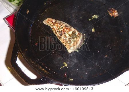 Tuna fish fillet steak in a pan smoke grill
