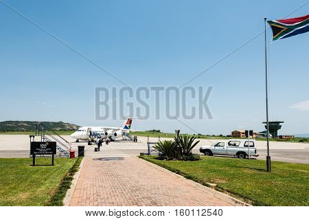 Nelspruit, South Africa - November 29, 2016: Cosy departure scene at Nelspruit Mpumalanga airport with the tower in the background. It serves travellers to the famous Kruger National Park near Nelspruit in South Africa.