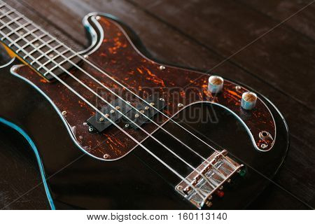 Electric guitar on a wooden surface. Conceptual background.