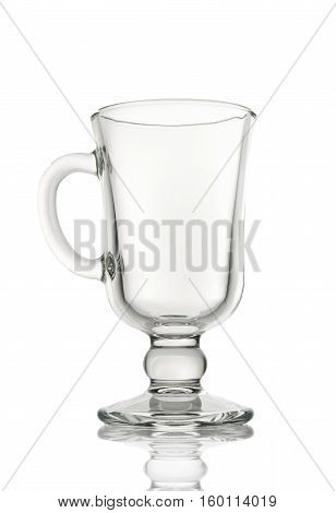 Empty glass irish coffee cup isolated on white