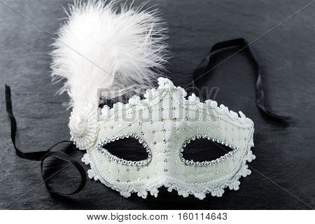 Carnival mask on black background - Symbols of Purim