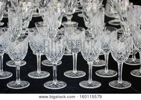 a set of wine glass on black table
