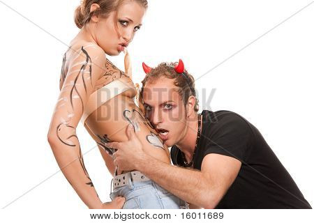 devil boy and  body-painted blonde woman