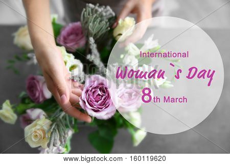 Female florist making bouquet. Text INTERNATIONAL WOMAN'S DAY, 8TH MARCH on background
