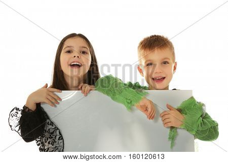 Cute kids with banner on light background. Halloween concept