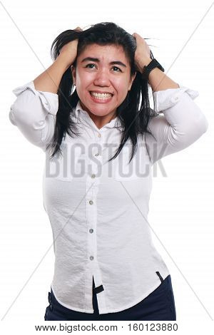 Photo image portrait of a stressed young Asian businesswoman looked so frustrated crying while holding hairs on her head half body close up portrait over white background