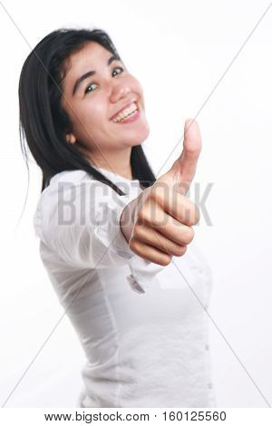 Photo image portrait of a beautiful cute young Asian woman smiling and showing thumb up gesture side view half body close up portrait over white focus on hand with blur face