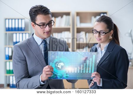 Business people discussing stock chart trends