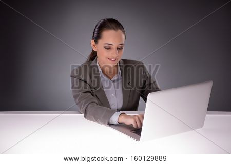Young businesswoman working with laptop in business concept