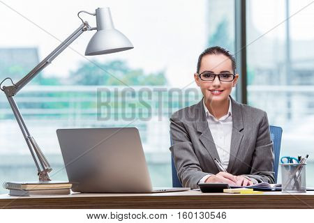 Young assistant working in the office