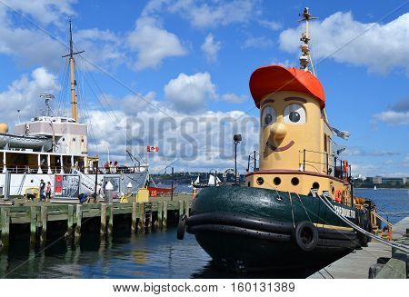 HALIFAX, NS - AUGUST, 2016: Theodore Too inspired by the children's cartoon character is docked at his home port at Halifax harbor.
