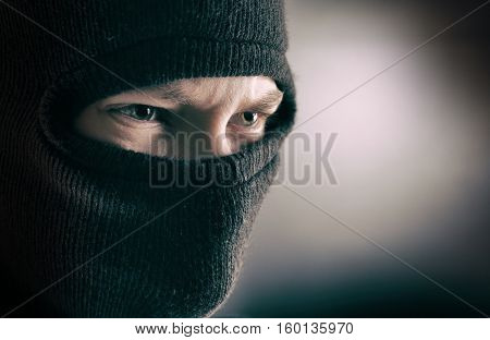 aggressive man in the mask