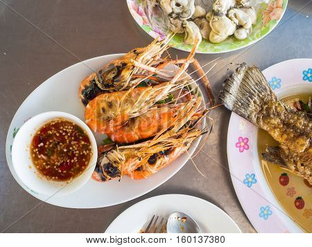 Grilled shrimps and seafood set served on the table.