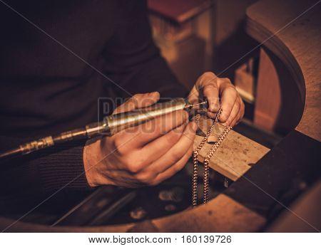 Jeweler at work in jewelery workshop