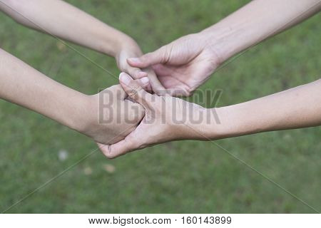 Young carer giving helping hands for a kid handicap