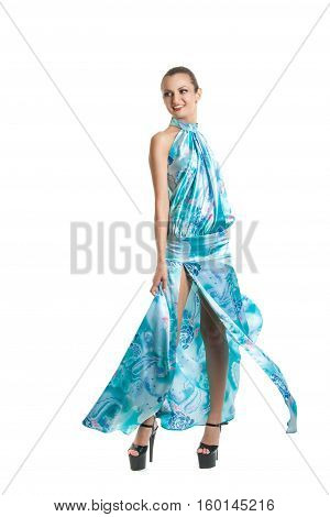 Fashion Portrait Of A Young Pretty Girl In A Blue Dress. Summer Light Dress Fluttering In The Wind,