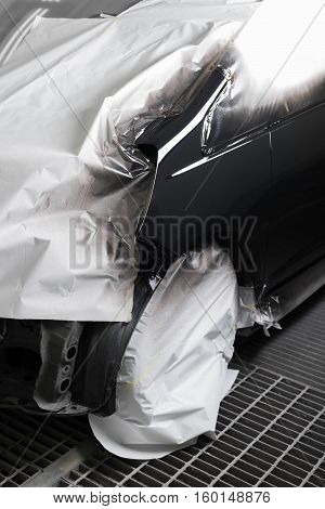Auto body repair series : Black car after repaint in paint booth