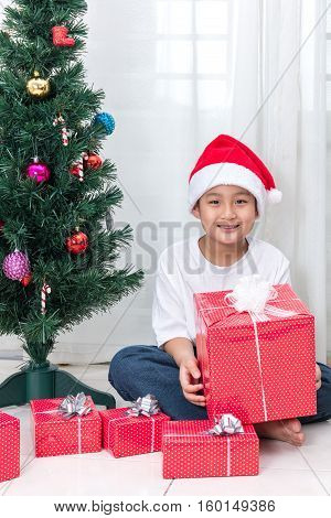 Asian Chinese Little Boy Holding Christmas Gift Box