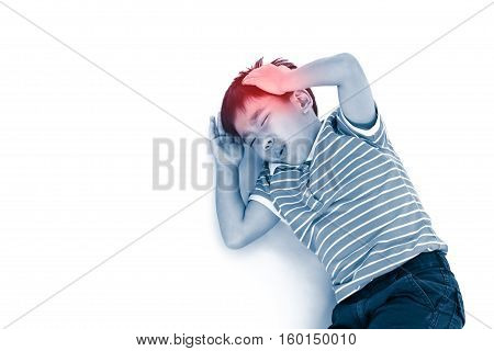 Top view child lie down. Asian boy have a headache his hand on head. Isolated on white background. Negative human emotion facial expression feeling reaction. Red spot indicating location of pain.