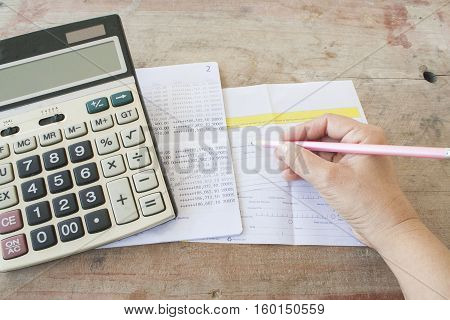 hand accounting bank and payment slip for financial expense and income
