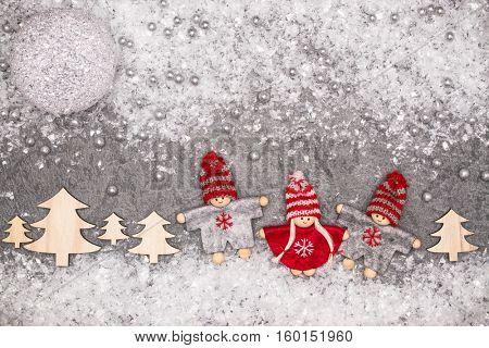 Christmas greeting card. Noel festive background. New year symbol. Children playing theme.