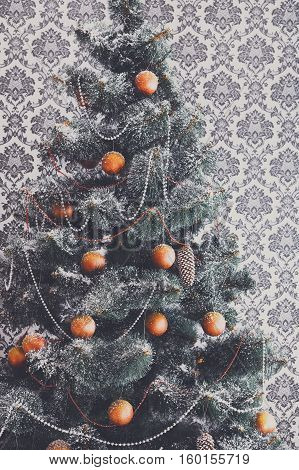 Beautiful decorated Christmas tree closeup in modern living room. Winter holiday design and decorations background