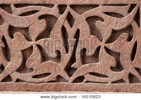 Close up of red stone carving at Qut'b Minar in Delhi.